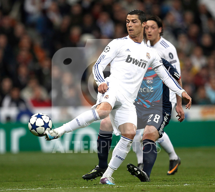 Real Madrid's Cristiano Ronaldo and Olimpique Lyon's during Champions League match in Madrid on March 16th 2011...