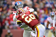 Landover, MD - December 9, 2018: Washington Redskins running back Adrian Peterson (26) is tackled by New York Giants cornerback Janoris Jenkins (20) during game between the New York Giants and Washington Redskins at FedEx Field in Landover, MD. The Giants defeated the Redskins 40-16 dropping the Redskins to 6-7 on the season. (Photo by Phillip Peters/Media Images International)