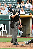 Home plate umpire Brandon Henson calls a strike during the game between the El Paso Chihuahuas and the Salt Lake Bees at Smith's Ballpark on August 7, 2014 in Salt Lake City, Utah.  (Stephen Smith/Four Seam Images)