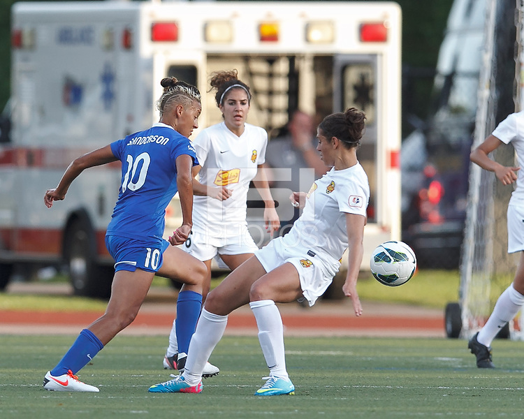 Boston Breakers forward Lianne Sanderson (10) slicing through the defense. In a National Women's Soccer League Elite (NWSL) match, the Boston Breakers (blue) tied Western New York Flash (white), 2-2, at Dilboy Stadium on June 5, 2013.
