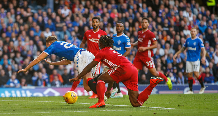 28.09.2018 Rangers v Aberdeen: Greg Stewart felled in the box by Greg Leigh for Rangers second penalty
