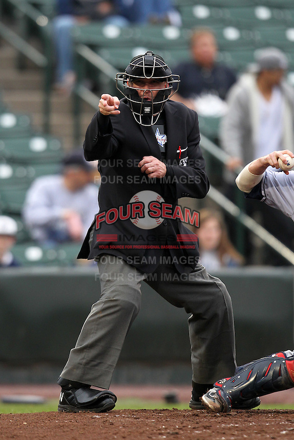 Home umpire Jeff Gosney makes a call during a game between the Empire State Yankees and Columbus Clippers at Frontier Field on May 8, 2012 in Rochester, New York.  Columbus defeated Empire State 1-0.  (Mike Janes/Four Seam Images)