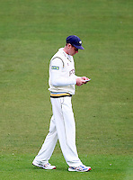 PICTURE BY VAUGHN RIDLEY/SWPIX.COM - Cricket - County Championship Div 2 - Yorkshire v Essex, Day 3 - Headingley, Leeds, England - 21/04/12 - Yorkshire's Andrew Gale reads a note.