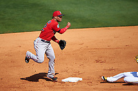 Boston Red Sox second baseman Yoan Moncada (22) attempts to turn a double play during a Spring Training game against the Pittsburgh Pirates on March 9, 2016 at McKechnie Field in Bradenton, Florida.  Boston defeated Pittsburgh 6-2.  (Mike Janes/Four Seam Images)