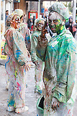 24/08/2014. London, England. Notting Hill Carnival 2014 starts with the traditional early-morning J'ouvert or Jouvet parade down Ladbroke Grove where revellers throw paint and flour.