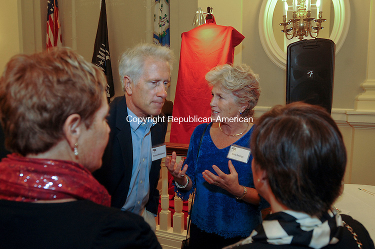 WATERBURY, CT-17 OCTOBER 2012--101712JS01--Molly Baldrige, daughter of the late Malcolm Baldrige, chats with Barbara Secor of Southbury, left, Richard Makepeace, second from left, and artist Susan Durkee of Redding during the unveiling of an oil painting of Malcolm Baldrige painted by Durkee, Wednesday at Waterbury City Hall Veteran's Memorial Hall. The unveiling was held in connection with the naming of The Malcolm Baldrige School of Business at Post University. .Jim Shannon Republican-American