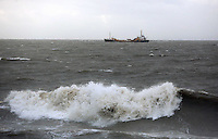 WEATHER PICTURE SWANSEA<br /> Pictured: A ship approaching Swansea docks in rough seas, south Wales. Monday 03 February 2014<br /> Re: High tides combined with strong winds are affecting parts of the UK.
