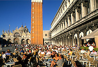 Crowds and tourists at cafe in front of the Famous St Marks Church in San Marcos Plaza in romantic Venice Ital