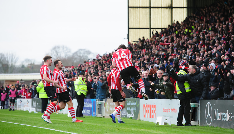 Lincoln City's Harry Toffolo, second in from right, celebrates scoring the opening goal with team-mates, from left, Lee Frecklington, Neal Eardley and Michael Bostwick<br /> <br /> Photographer Chris Vaughan/CameraSport<br /> <br /> The EFL Sky Bet League Two - Lincoln City v Grimsby Town - Saturday 19 January 2019 - Sincil Bank - Lincoln<br /> <br /> World Copyright &copy; 2019 CameraSport. All rights reserved. 43 Linden Ave. Countesthorpe. Leicester. England. LE8 5PG - Tel: +44 (0) 116 277 4147 - admin@camerasport.com - www.camerasport.com