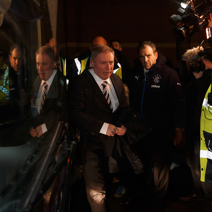Rangers manager Ally McCoist gets off the team bus at Palmerston Park tonight