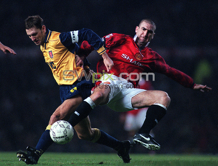 Pix:Michael Steele/SWpix...Soccer. Manchester United v Arsenal...COPYRIGHT PICTURE>>SIMON WILKINSON..Arsenals Tony Adams and Manchesters Uniteds Eric Cantona.