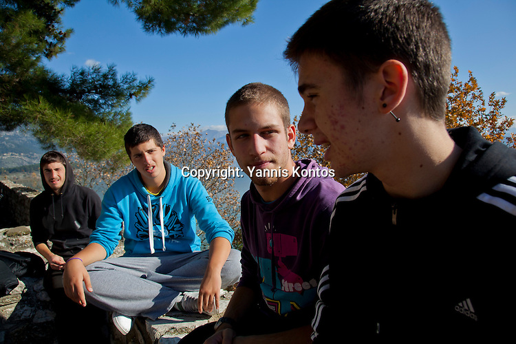 Greek students from left: Dinos Athanasiou,18, Andreas Nasios,18, Christos Dimitriadis,18, and Konstantinos Vartziotis,18, relax from their lessons near by the Ioannina lake.