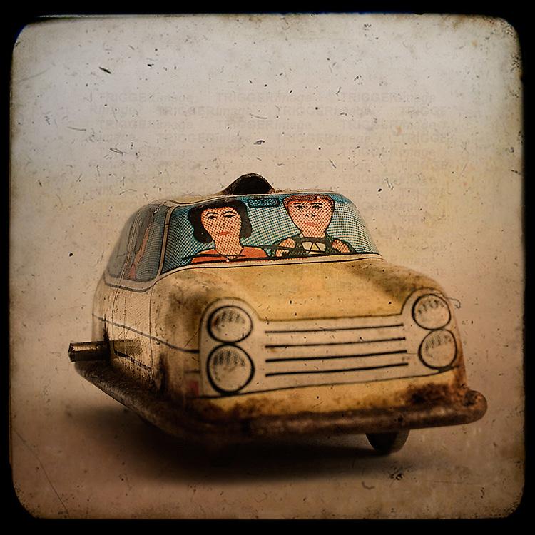 An old tin toy car