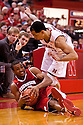 27 December 2011: Jordan Taylor #11 of the Wisconsin Badgers tries to save the ball before going out of bounds while Bo Spencer #23 of the Nebraska Cornhuskers tries to keep from falling on him during the first half at the Devaney Sports Center in Lincoln, Nebraska. Wisconsin defeated Nebraska 64 to 40.