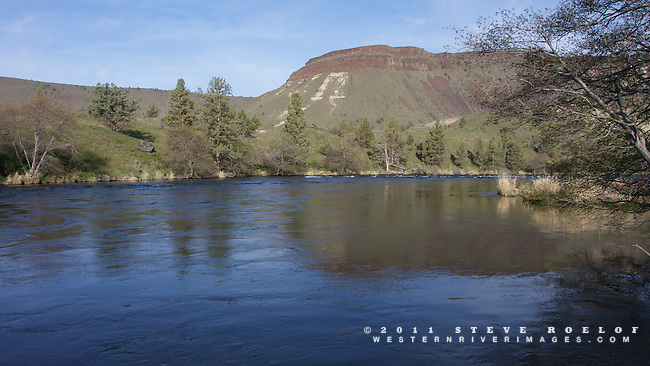 The blue sky of morning reflects on the Deschutes River, Oregon.