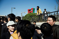 Tourists line up at the Deshengmen Gate in Beijing, China, for public buses to the Badaling entrance of the Great Wall.