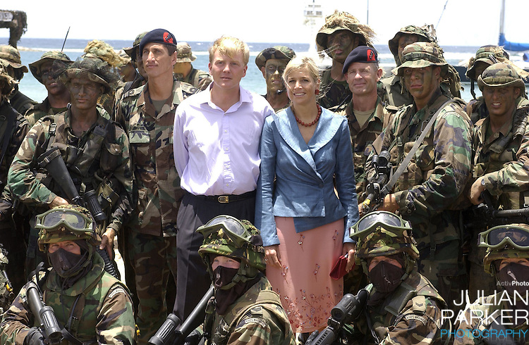 Crown Prince Willem Alexander, and Crown Princess Maxima of Holland visit The Dutch Antilles..Visit the Island of Aruba..The Royal Couples program included, a visit to The Dutch Marine Base, an Elementary School, The YMCA, and watched a cultural presentation.