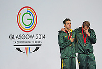 Republic of South Africa's Chad le Clos, left, on the podium after winning the men's 200m butterfly during the national anthem.  Also pictures is bronze medalist  Republic of South Africa's Sebastien Rousseau<br /> <br /> Photographer Chris Vaughan/CameraSport<br /> <br /> 20th Commonwealth Games - Day 3 - Saturday 26th July 2014 - Swimming - Tollcross International Swimming Centre - Glasgow - UK<br /> <br /> © CameraSport - 43 Linden Ave. Countesthorpe. Leicester. England. LE8 5PG - Tel: +44 (0) 116 277 4147 - admin@camerasport.com - www.camerasport.com