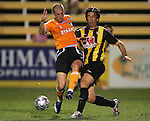 28 March 2007: Houston's Paul Dalglish (left)  passes the ball away from Charleston's Chris Gores (right). The Houston Dynamo tied the Charleston Battery 1-1 at Blackbaud Stadium in Charleston, South Carolina in a Carolina Challenge Cup preseason match.