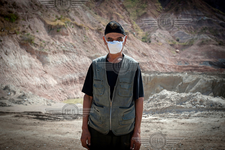 Aleck Abdaliev, 60, from Jalal-Abad, stands at the entrance of the Dump No.3 where he works. Workers make about 20,000 Somoni (GBP 2,650) in 2 weeks. Due to the pollution they ingest while working, staff work two weeks on and two weeks off....
