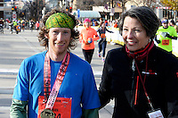 Madison's Brian Condon wins the Men's Full Marathon and is presented with a medal by Madison Festivals President, Rita Kelliher, during the 2014 Madison Marathon on Sunday, November 9, 2014, in Madison, Wisconsin