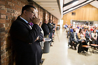 NWA Democrat-Gazette/CHARLIE KAIJO Head of School, John Rocha (left), listens to speakers during an open house, Sunday, March 4, 2018 at Ozark Catholic Academy in Tontitown.<br /><br />Ozark Catholic Academy, which is gearing up to open this fall, celebrated a milestone as they announced their mascot.