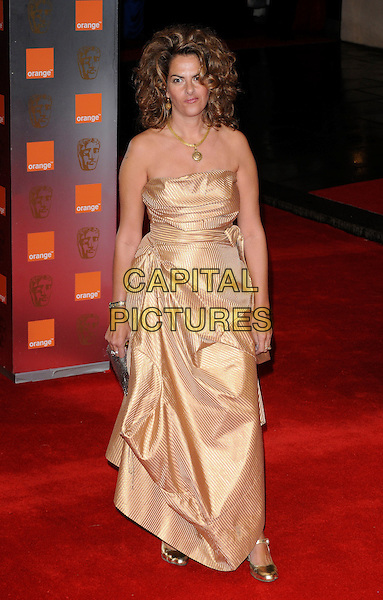 TRACEY EMIN.2011 Orange British Academy Film Awards (Baftas) at The Royal Opera House, London, England, UK,.February 13th, 2011..arrivals BAFTA full length hair curly big volume gold strapless dress silk satin shoes silver .CAP/CAN.©Can Nguyen/Capital Pictures.