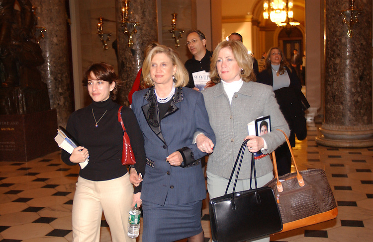 12/06/04.INTELLIGENCE REFORM BILL--Family members Carie Lemack, left, and Mary Fetchet, right, with Carolyn B. Maloney, D-N.Y., with other family members on their way through Statuary Hall to deliver a petition to House Speaker J. Dennis Hastert, R-Ill., urging him to schedule a vote on the intelligence reform bill before the imminent end of the 108th Congress..CONGRESSIONAL QUARTERLY PHOTO BY SCOTT J. FERRELL