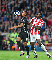 Anthony Martial of Man Utd controls under pressure from Kurt Zouma of Stoke City during the Premier League match between Stoke City and Manchester United at the Britannia Stadium, Stoke-on-Trent, England on 9 September 2017. Photo by Andy Rowland.