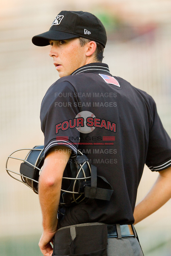 Home plate umpire Thomas Newsom during a South Atlantic League game between the Greensboro Grasshoppers and the Kannapolis Intimidators at Fieldcrest Cannon Stadium August 3, 2010, in Kannapolis, North Carolina.  Photo by Brian Westerholt / Four Seam Images