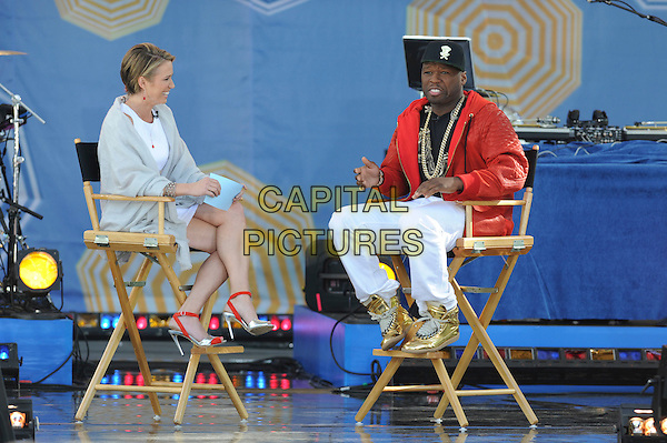 New York, NY- May 30: Curtis &quot;50 Cent&quot; Jackson talks to GMA host Amy Robach about his &quot;first pitch&quot; at Citi Field  prior to his performance as part of the GMA Summer Concert Series at Rumsey Playfield in Central Park on May 30, 2014 in New York City..  <br /> CAP/RTNSTV<br /> &copy;RTNSTV/MPI/Capital Pictures