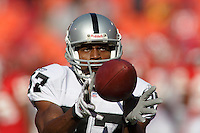 Oakland Raiders WR Alvis Whitted catches a pass as he warms up before the game at Arrowhead Stadium in Kansas City, Missouri on November 19, 2006. The Chiefs won 17-13.