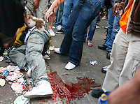 30.08.10 A man lies on the floor next a a puddle of his blood after being hit by a bottle and was repeatedly stamped on at Notting Hill Carnival.