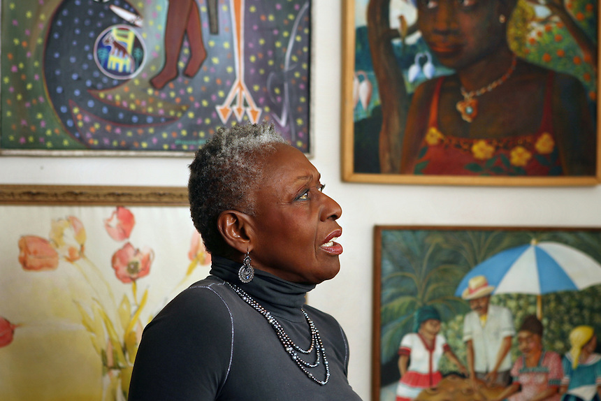 Former model and modelling agency owner BETHANN HARDISON at home amid her collection of Haitian, folk and outsider art.  She is voicing her concern about the absence of women of color on the runway.  237 E. 20 st., NYC.  Newsday/ARI MINTZ  1/17/2008.