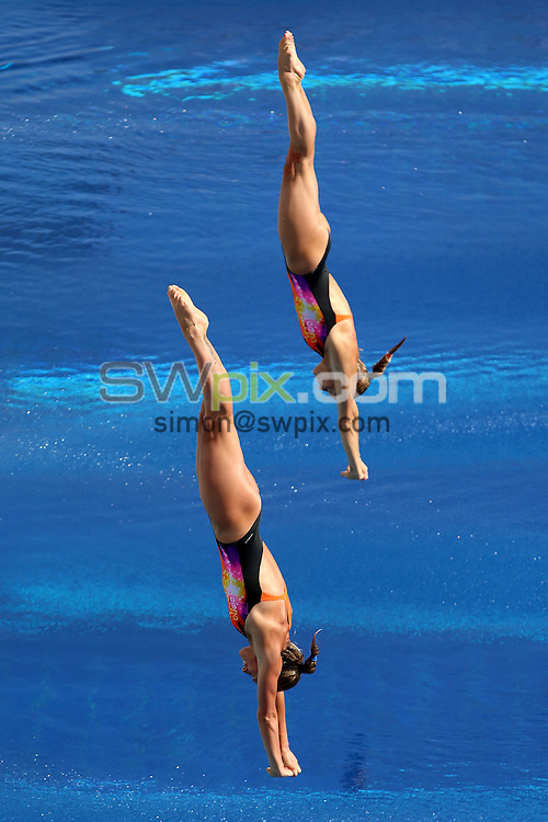 PICTURE BY VAUGHN RIDLEY/SWPIX.COM - Diving - 15th FINA World Championships 2013 - Monjtuic Municipal Swimming Pool, Barcelona, Spain - 20/07/13 - Italy's Tania Cognotto and Francesca Dallape compete in the Women's 3m Synchro Preliminary.