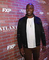 """LOS ANGELES - FEBRUARY 19: Kevin Daniels arrives at the red carpet event for FX's """"Atlanta Robbin' Season"""" at the Ace Theatre on February 19, 2018 in Los Angeles, California.(Photo by Frank Micelotta/FX/PictureGroup)"""
