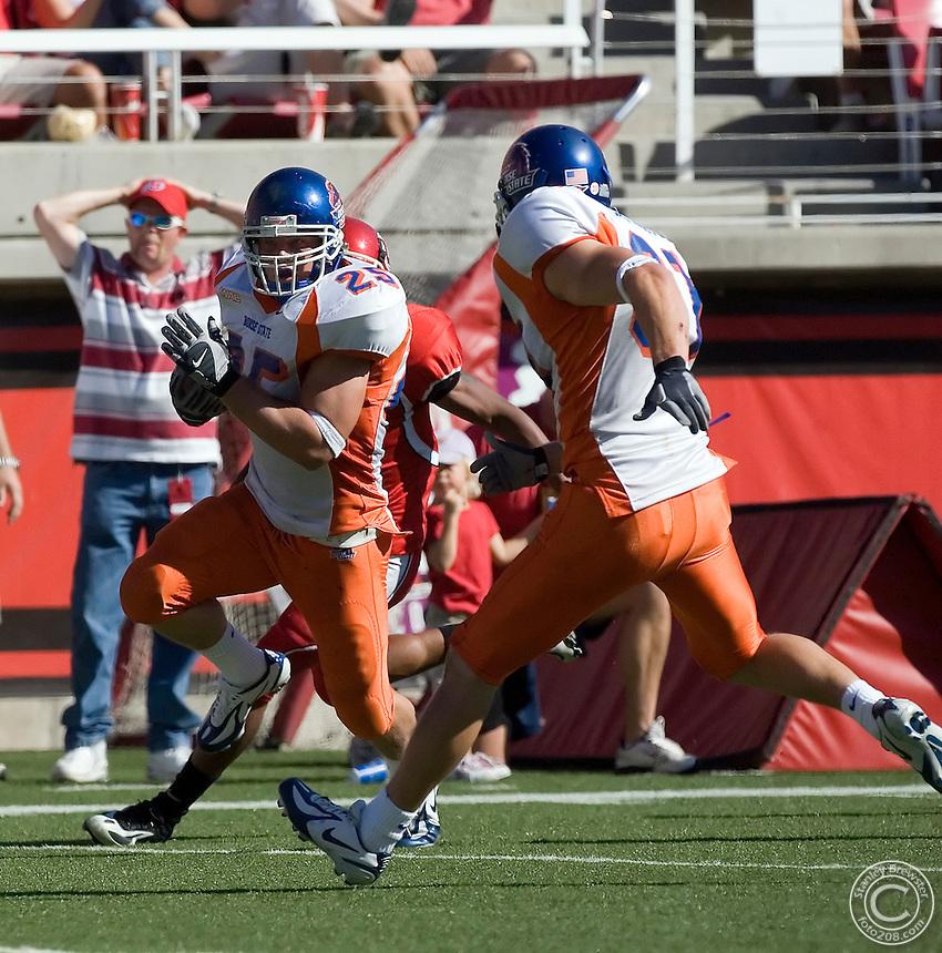 30 September 2006: Boise State linebacker Kory Hall returns an interception back for a touchdown as the Broncos beat the Utah Utes 36-3 in Rice-Eccles Stadium in Salt Lakes City Utah.