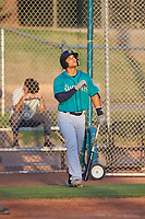 AZL Mariners Freuddy Batista (19) points toward the sky before an at bat during an Arizona League game against the AZL Giants Orange on July 18, 2019 at the Giants Baseball Complex in Scottsdale, Arizona. The AZL Giants Orange defeated the AZL Mariners 7-4. (Zachary Lucy/Four Seam Images)