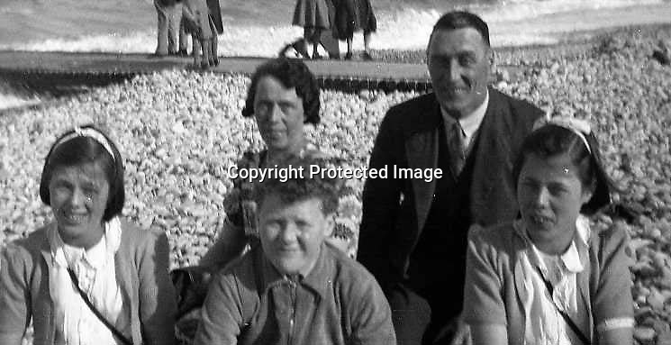 BNPS.co.uk.(01202 558833)<br /> Pic: FinnWebster/BNPS<br /> <br /> Nevile Jones and sisters Edna and Iris with parents Rueben and Marg on a trip to the seaside in the 1930's.<br /> <br /> Britain's oldest set of triplets whose combined weight at birth was the same as a normal baby have celebrated their 85th birthday.<br /> <br /> Neville Jones and sisters Edna Doodson and Iris Hopkin were born just 20 minutes apart in June 1929.<br /> <br /> Twins had run in the family and their mother Margaret had been expecting two babies before youngest sibling Iris arrived to make it a hat-trick.<br /> <br /> She weighed just 2lbs and was given little chance of survival but pulled through. Edna weighed 3lbs and Neville a healthier 4lbs.