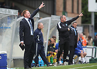 Wycombe Wanderers Manager, Gary Waddock, former QPR player and Republic of Ireland International urges his team on from the sidelines during Wycombe Wanderers vs Colchester United, Coca Cola League Division One Football at Adams Park on 17th October 2009
