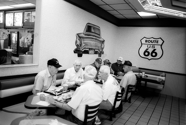 Route 66: Men at McDonald's with a Route 66 sign, Chelsea, OK.