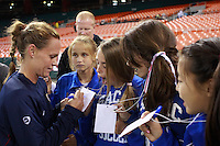 United States defender Christie Rampone (3) signs autographs after the game. The women's national team of the United States defeated Canada 6-0 during an international friendly at Robert F. Kennedy Memorial Stadium in Washington, D. C., on May 10, 2008.