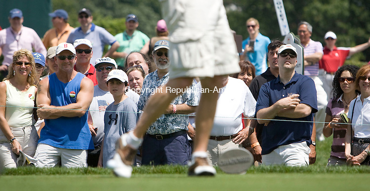 CROMWELL, CT - 23 JUNE 2010 -062310JT09-<br /> Golf fans watch as ESPN commentator Karl Ravech tees off at the 1st tee during Wednesday's Travelers Celebrity Pro-Am golf event at TPC River Highlands in Cromwell.<br /> Josalee Thrift Republican-American