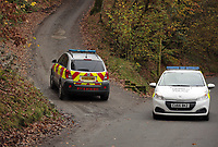 Pictured: Police a fire service vehicle at the entrance to the track leading to the house that burned in Llangammarch Wells, Powys, Wales, UK. Tuesday 31 October 2017<br /> Re: Investigations continue into a house fire in which a father and several of his children have died.<br /> Three children aged 13, 12 and 10 escaped the farmhouse in Llangammarch Wells, Powys, in the early hours of Monday and raised the alarm.<br /> Police said they could not identify the deceased or confirm numbers.<br /> One of those missing has been named locally as David Cuthbertson.