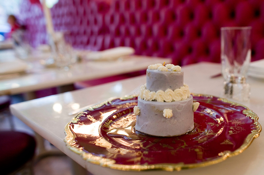 A serving of cake that resembles a wedding cake.
