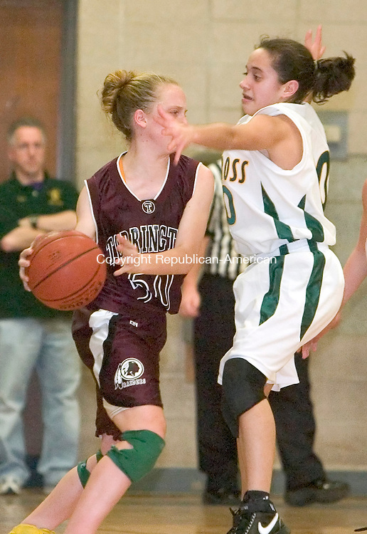 WATERBURY, CT-- 08 JANUARY 2008--010808JS04-Torrington's Michelle Royals looks to pass the ball while being defended by Holy Cross' Nicole Sills (10) during their game Tuesday at Holy Cross High School in Waterbury. <br /> Jim Shannon/Republican-American