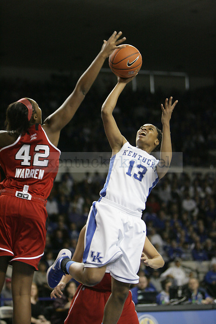 Freshman guard Bria Goss goes for a layup with pressure from Louisville sophomore center Cierra Warren during the first half of UK Hoop's home game against Louisville at Memorial Coliseum in Lexington, Ky., Dec. 4, 2011. Photo by Brandon Goodwin