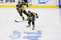 May 31, 2017: Pittsburgh Penguins defenseman Justin Schultz (4) and defenseman Ian Cole (28) track the flight of the puck during game two of the National Hockey League Stanley Cup Finals between the Nashville Predators  and the Pittsburgh Penguins, held at PPG Paints Arena, in Pittsburgh, PA. The Penguins defeat the Predators 4-1 and lead the series 2-0. Eric Canha/CSM