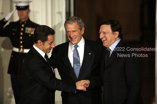 Washington, DC - November 14, 2008 -- United States President George W. Bush greets Nicolas Sarkozy, President of France and Jose Manuel Barroso, President of the European Commission to the White House for a working dinner at the start of the G20 Summit on Financial Markets and the World Economy. .Credit: Gary Fabiano - Pool via CNP