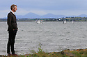 TRAVEL PIECE TO GO WITH GLENN PATTERSON COUNTY DOWN - Glenn Patterson stands on one of many low walls on the Portaferry Road looking towards Strangford Lough, County Down, Northern Ireland.  Photo/Paul McErlane